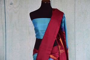 Buy this traditional Indian red and blue kanjivaram saree perfect for any wedding, reception, sangeet or engagement, puja and garba online or from our store in USA. Top View.