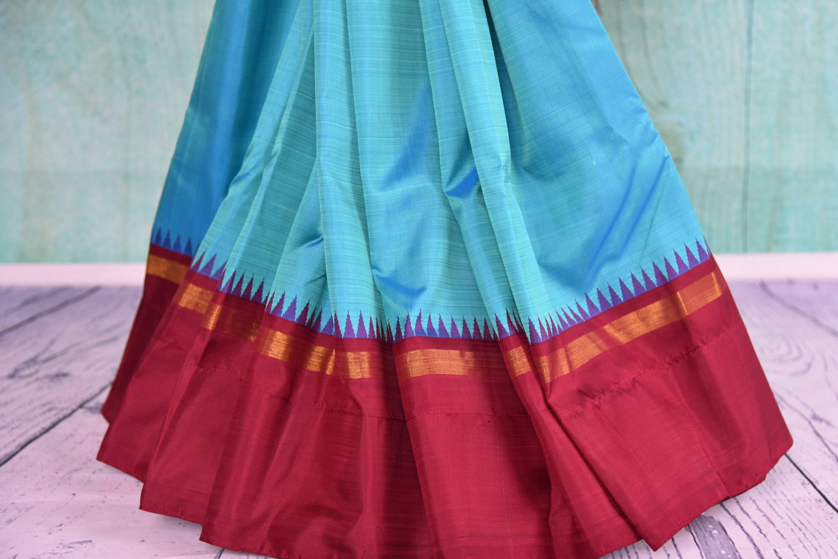 Buy this traditional Indian red and blue kanjivaram saree perfect for any wedding, reception, sangeet or engagement, puja and garba online or from our store in USA. Close up.
