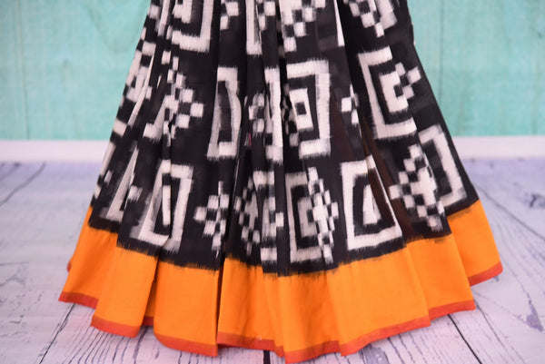 90D428 Black, white and orange printed sari ideal for ethnic festive occasions. Buy this cotton ikkat saree from our premium Indian fashion website in USA - Pure Elegance.
