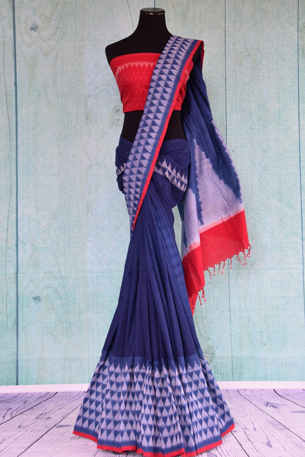 90D429 This blue and red saree makes for a great Indian outfit for pujas and casual occasions. This traditional silk ikkat saree with red blouse can be bought online in USA at our ethnic wear store.