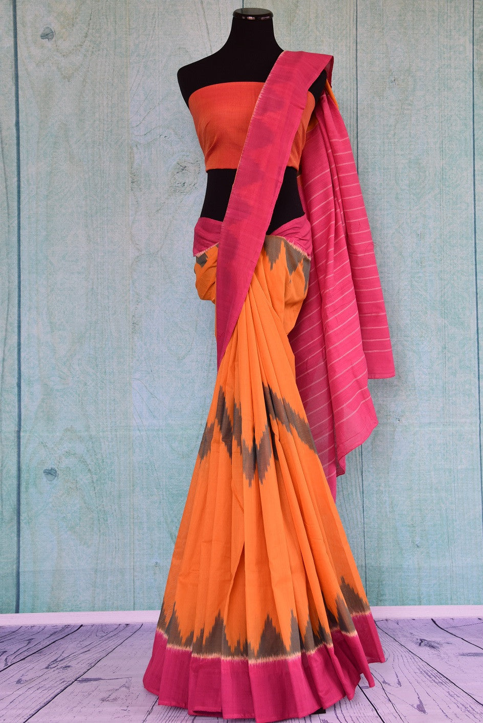 90D340 Traditional cotton ikkat saree that works well for pujas and festivals. The yellow and pink sari can be bought at our ethnic wear store online - Pure Elegance.