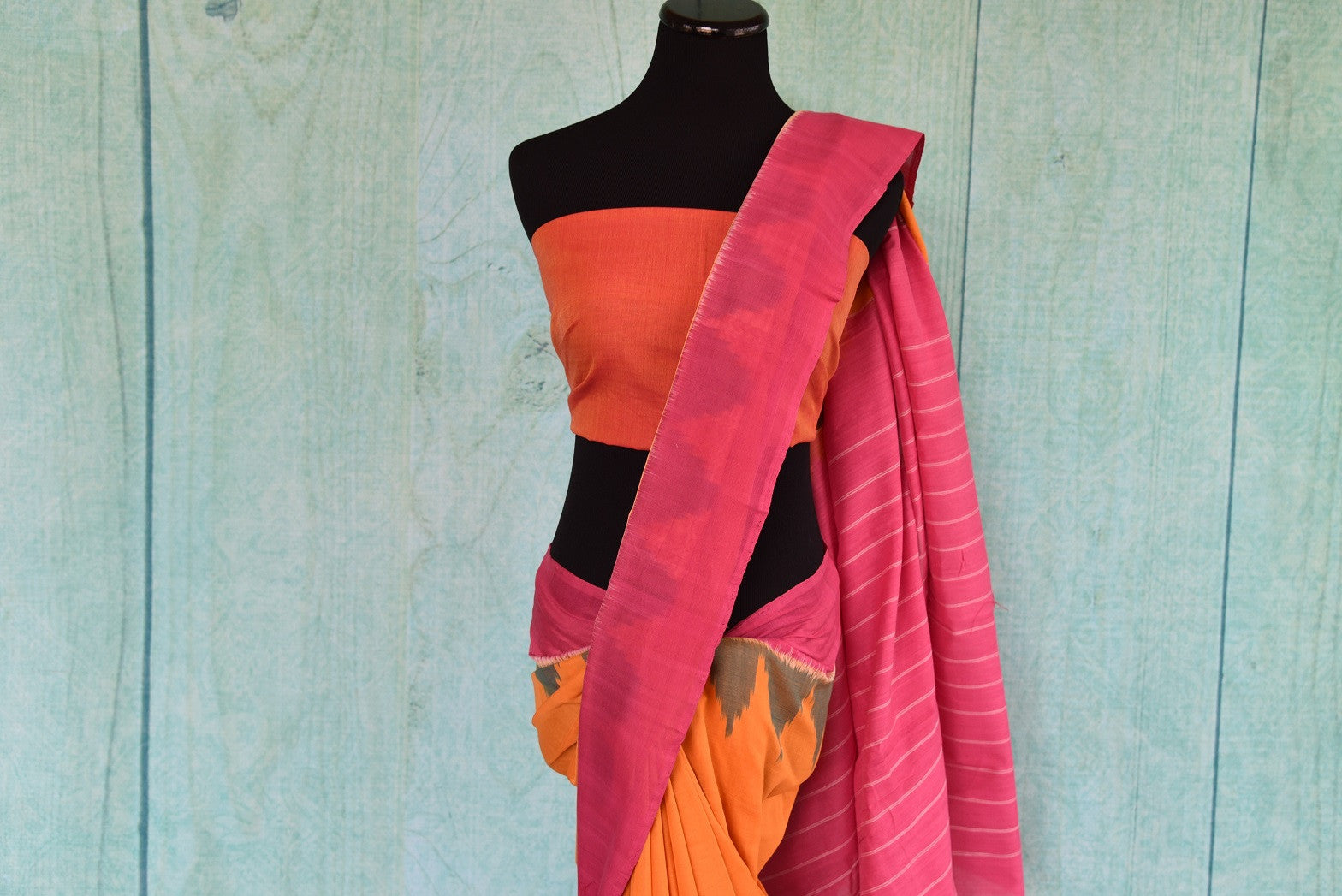 90D340 Traditional cotton ikkat saree that works well for pujas and festivals. The pink and yellow sari can be bought at our ethnic Indian wear store online - Pure Elegance.
