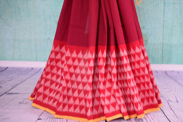 90D433 Traditional red saree with pink pattern, with yellow blouse & border trims. The cotton ikkat saree is a classic ethnic outfit, available online in USA at Pure Elegance, ideal for pujas and festivals.