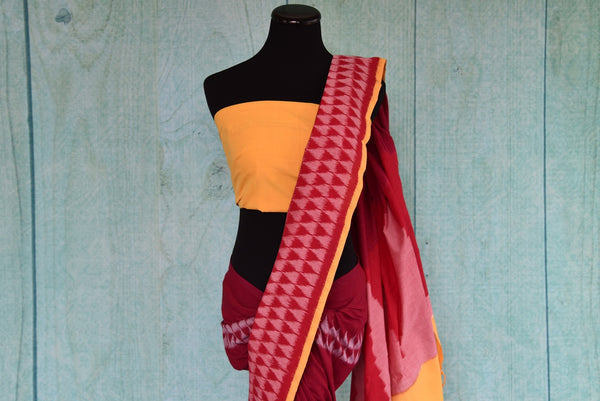 90D433 Traditional red saree with pink pattern, with yellow blouse & border trims. The cotton ikkat saree is a classic ethnic outfit, available online in USA at Pure Elegance, well suited for pujas and festivals.