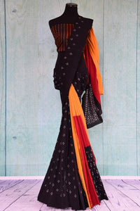 90D434 Bold ethnic saree with traditional Indian design. The black cotton ikkat saree has pops of red and yellow and can be bought at our Indian clothing store online in USA - Pure Elegance.