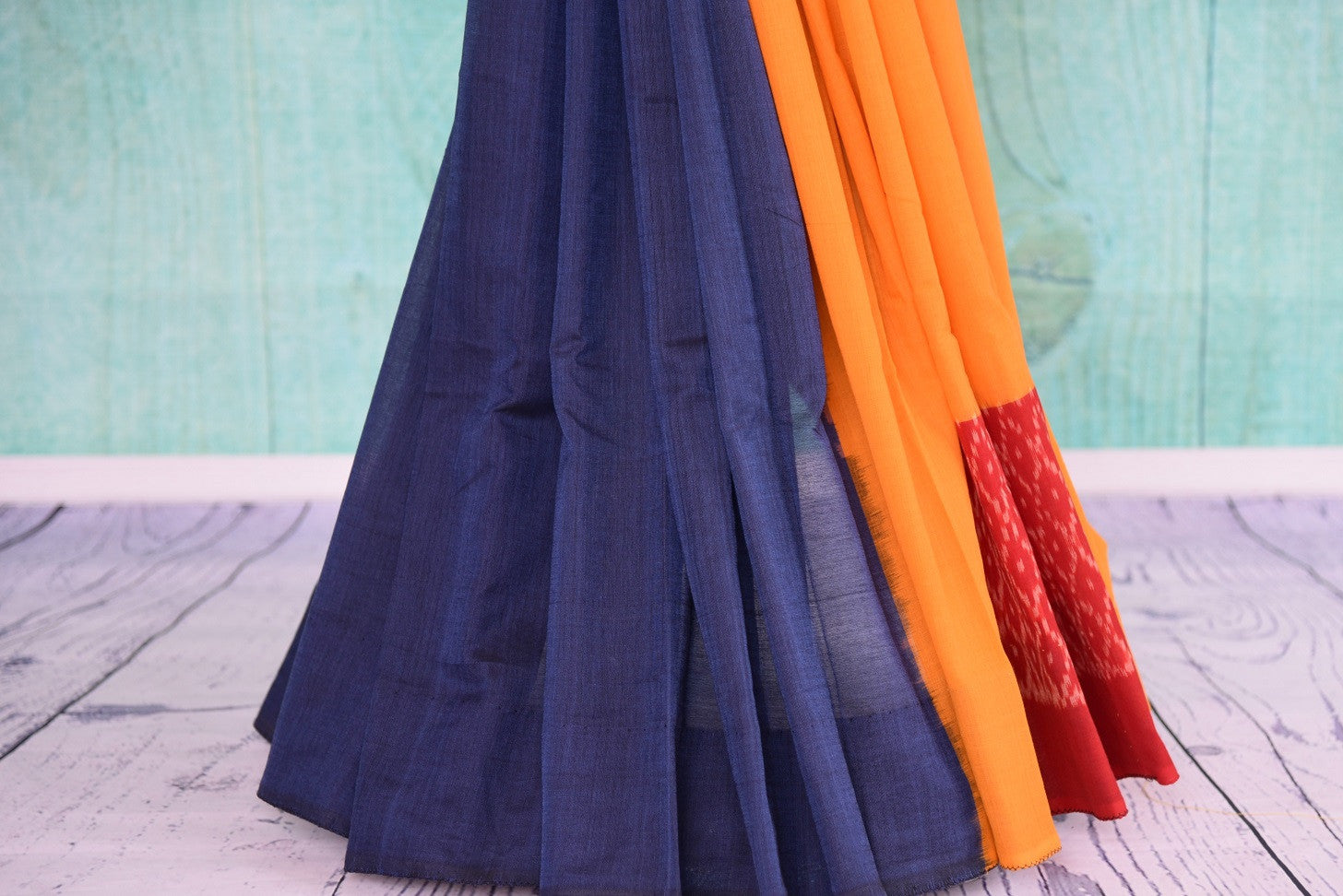 90D435 Bold blue, yellow & red, plain sari available at our online ethnic fashion store Pure Elegance in USA. The cotton ikkat saree makes for the ideal Indian party wear outfit.