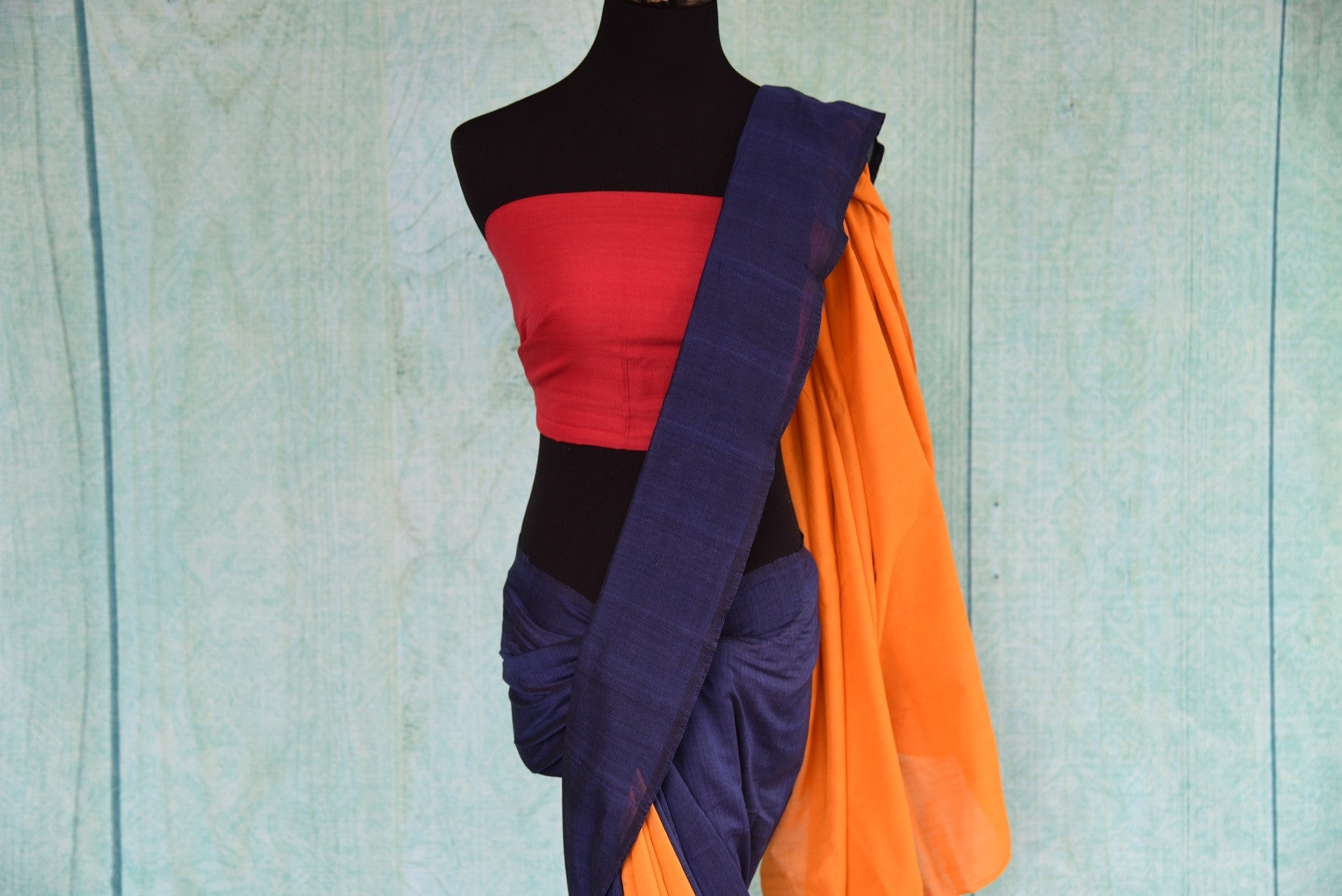 90D435 Blue, yellow & red, plain sari available at our ethnic fashion store Pure Elegance online and at Edison, USA. The cotton ikkat saree makes for the ideal Indian party wear outfit.