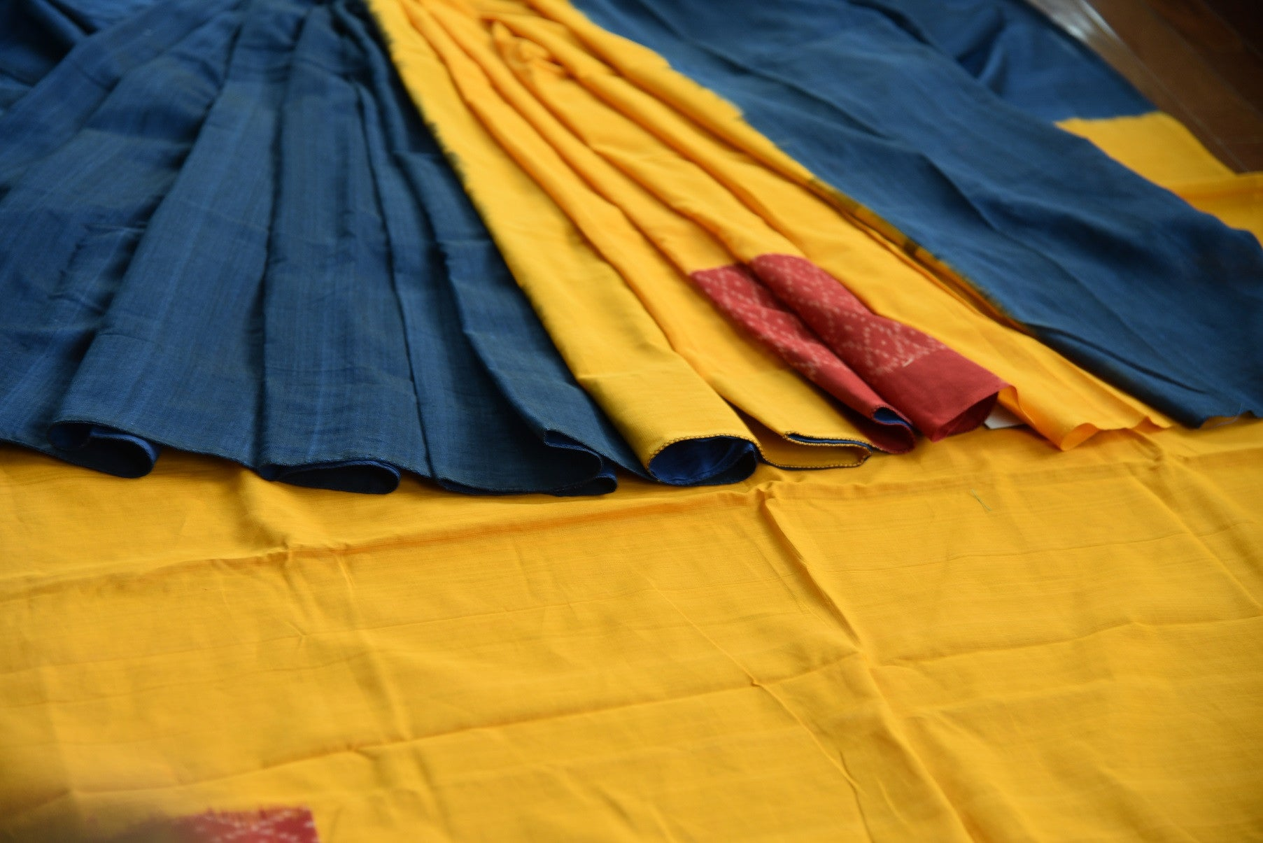 90D435 Bold blue, yellow & red, plain sari available at our online ethnic fashion store Pure Elegance in USA. The lovely cotton ikkat saree is a great Indian party wear outfit.