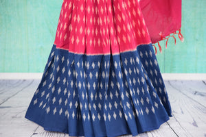 90D436 Cotton ikkat saree with traditional Indian pattern & plain pallu. The evergreen red and blue sari will be a great addition to your ethnic clothing collection and is available at Pure Elegance.