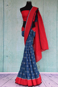90D437 Cotton ikkat traditional saree available at our Indian clothing store in USA - Pure Elegance. The red and blue sari makes for a great pick for pujas and Indian festivals.