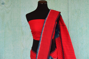 90D437 Traditional cotton ikkat saree available at our Indian clothing store in USA - Pure Elegance. The red and blue sari makes for a great pick for pujas and Indian festivals.