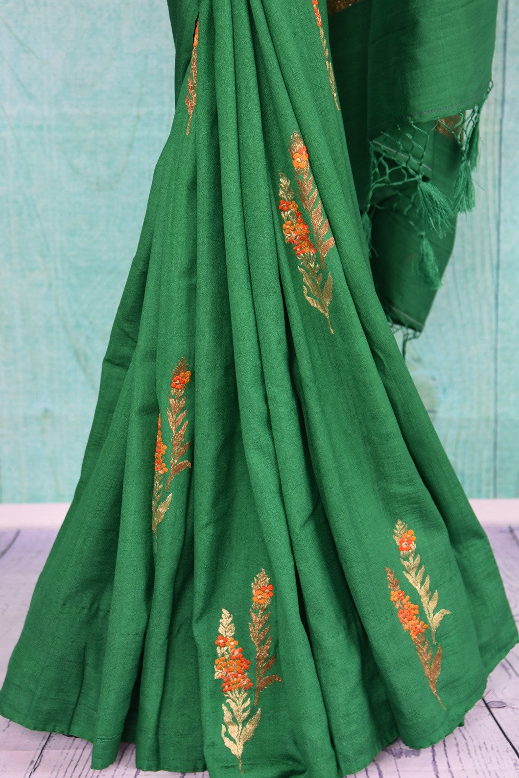 90D439 Elegant floral green sari that makes for a great ethnic outfit for parties and Indian weddings. Buy this evergreen tussar georgette banarasi saree online in USA at our store Pure Elegance.