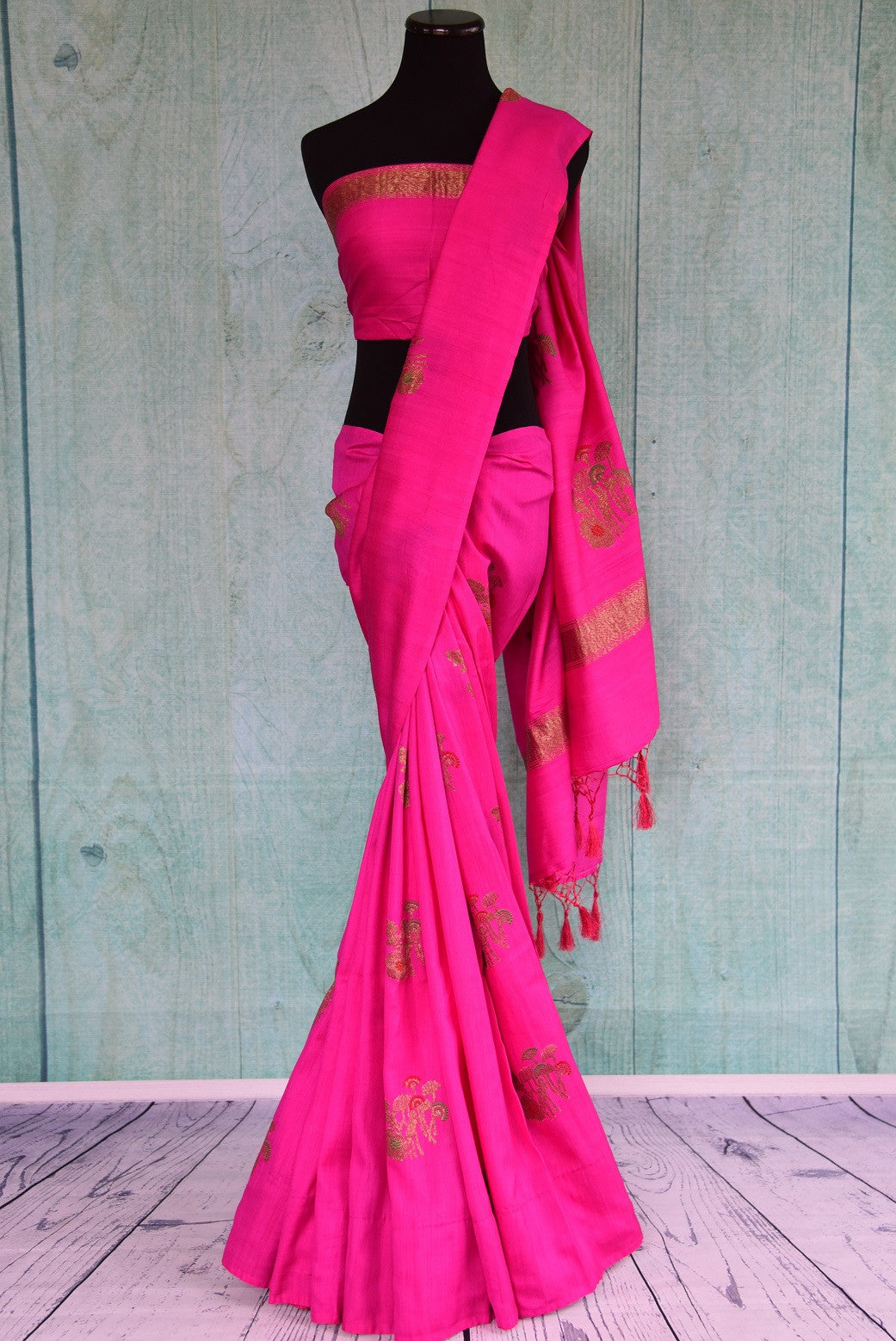 90D440 Rani pink saree with traditional golden motifs, available at Pure Elegance, our Indian wear store in USA. The traditional tussar georgette Banarasi saree is ideal for Indian weddings functions.