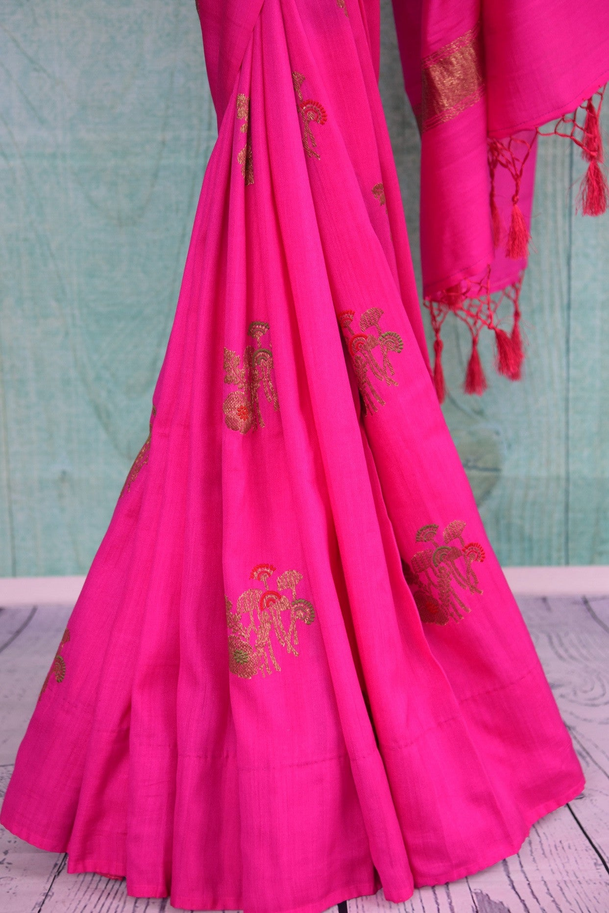 90D440 Rani pink saree with traditional golden motifs, available at Pure Elegance, our Indian wear store in USA. The traditional tussar georgette Banarasi saree the perfect pick for Indian weddings functions.