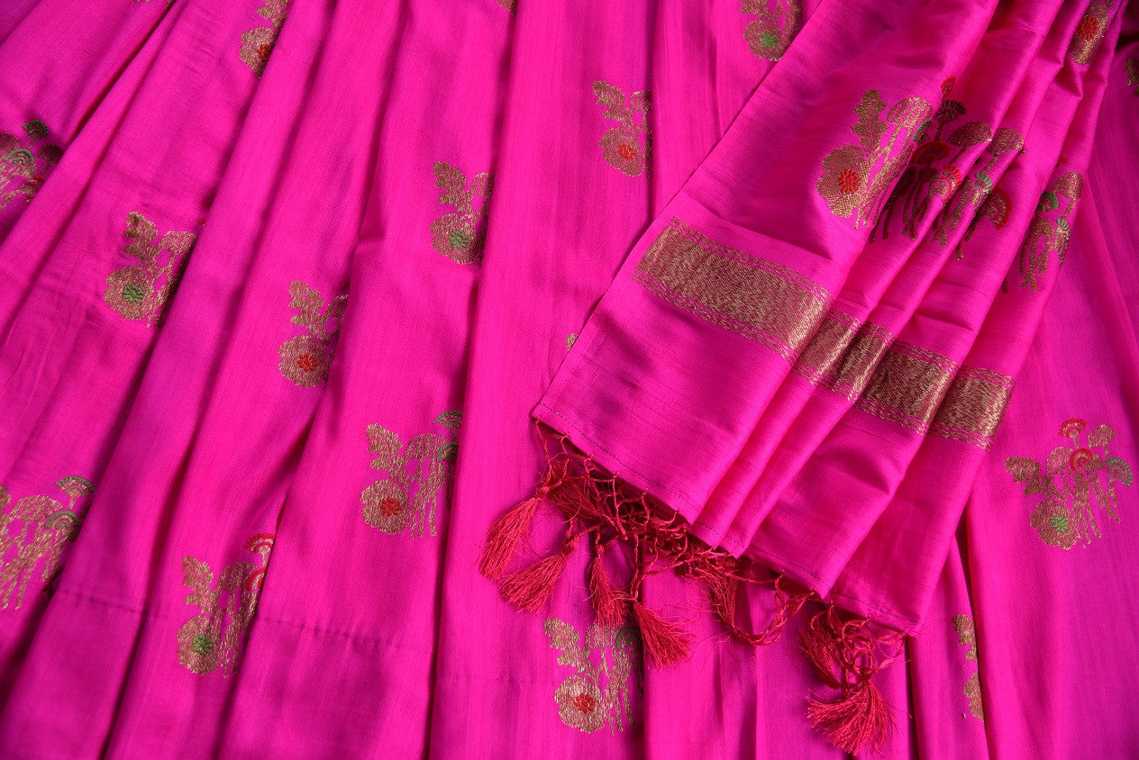90D440 Buy this rani pink saree with traditional golden motifs, at Pure Elegance, our Indian wear store in USA. The traditional tussar georgette Banarasi saree is ideal for Indian weddings functions.