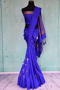 90D441 Royal and bold blue sari with traditional golden motifs. The tussar georgette saree, available in USA at Pure Elegance is a perfect ethnic outfit for Indian wedding functions.
