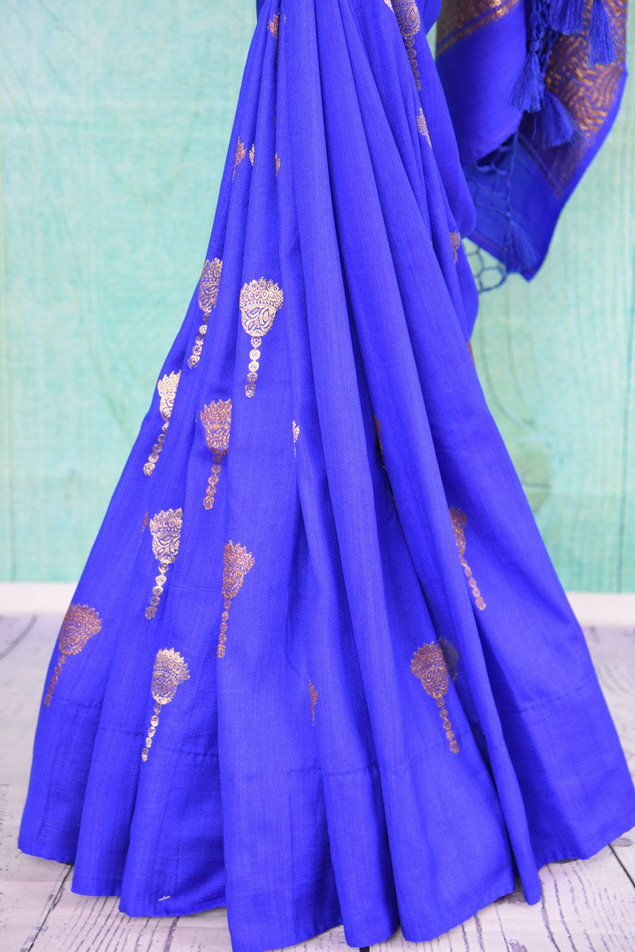 90D441 Royal and bold blue sari with traditional golden motifs. The tussar georgette saree, available in USA at Pure Elegance makes for a perfect ethnic outfit for Indian weddings and functions.