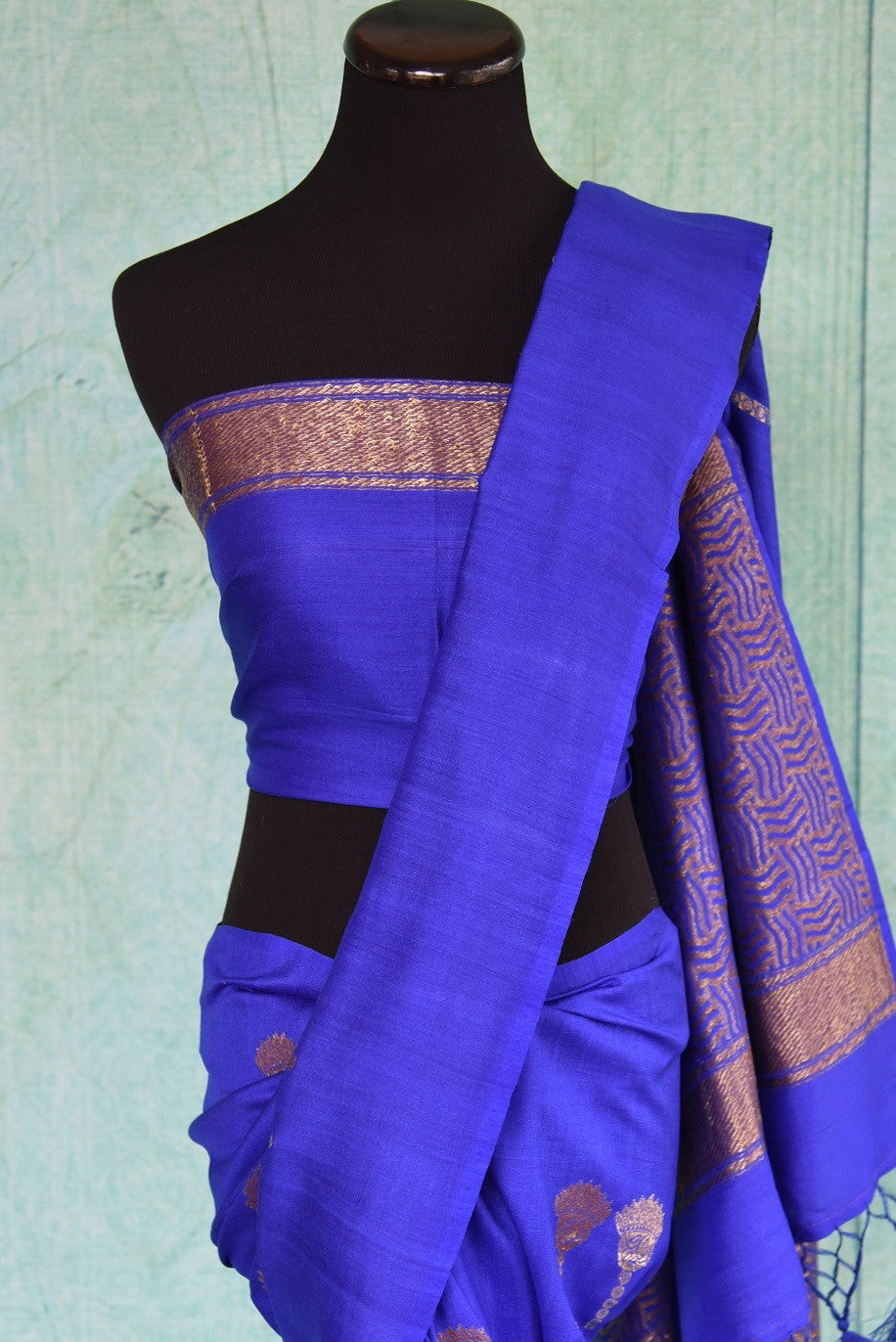 90D441 Royal and bold blue sari with traditional golden motifs. The tussar georgette saree, available online at Pure Elegance is a perfect ethnic outfit for Indian wedding functions.