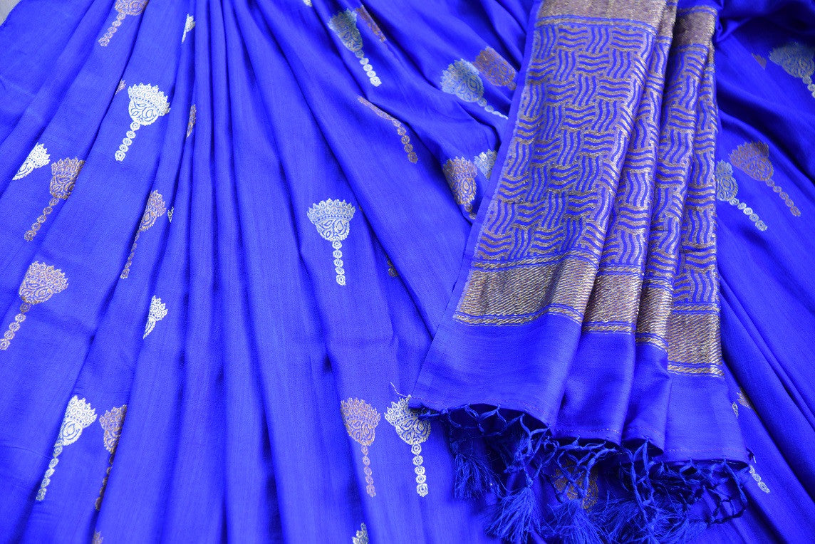 90D441 Bold royal blue sari with traditional golden motifs. The tussar georgette saree, available in USA at Pure Elegance is a perfect ethnic outfit for Indian wedding functions.