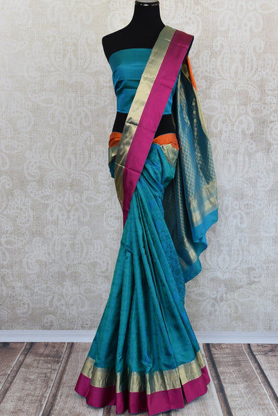 Knajivaram silk saree only at Pure Elegance. Blue saree with pink and orange silk border; shop online and at store in USA- for traditional Indian event, wedding - front view