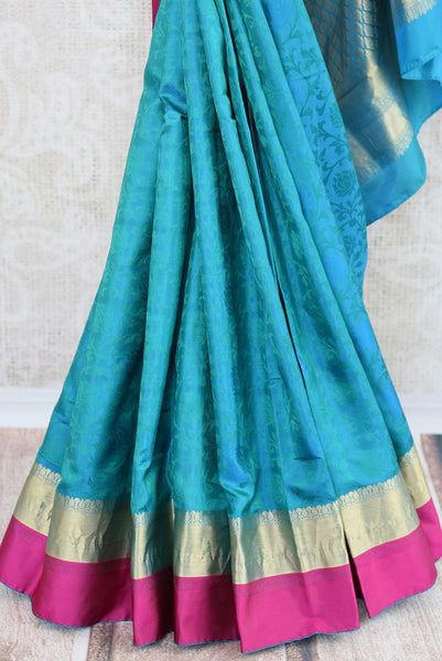 Knajivaram silk saree only at Pure Elegance. Blue saree with pink and orange silk border; shop online and at store in USA- for traditional Indian event, wedding - bottom close up
