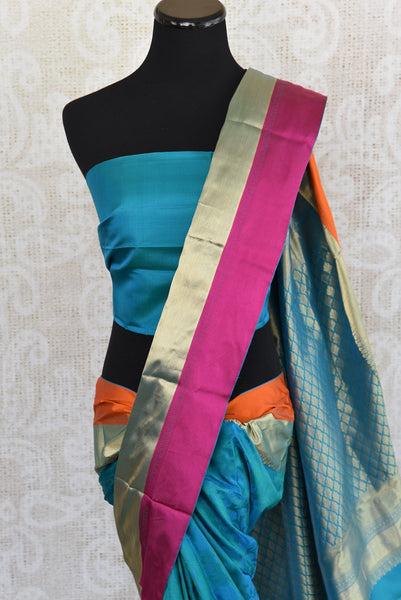 Knajivaram silk saree only at Pure Elegance. Blue saree with pink and orange silk border; shop online and at store in USA- for traditional Indian event, wedding - close up