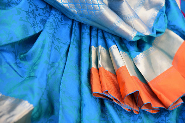 Knajivaram silk saree only at Pure Elegance. Blue saree with pink and orange silk border; shop online and at store in USA- for traditional Indian event, wedding - over all view close up