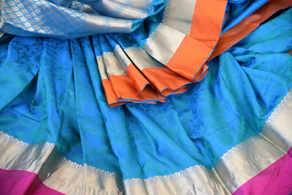 Knajivaram silk saree only at Pure Elegance. Blue saree with pink and orange silk border; shop online and at store in USA- for traditional Indian event, wedding- over all view