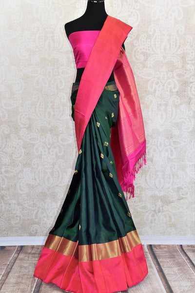 Classic and Elegant green and pink kanjivaram silk saree which have buta on all over body availlable at Pure Elegance on line and in store.  great buy for party-full view