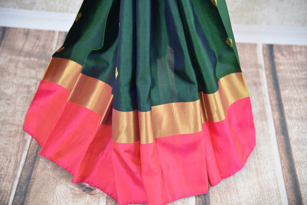 Classic and Elegant green and pink kanjivaram silk saree which have buta on all over body availlable at Pure Elegance on line and in store.  great buy for party- Pleats and border view