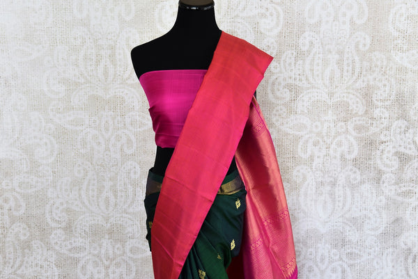 Classic and Elegant green and pink kanjivaram silk saree which have buta on all over body availlable at Pure Elegance on line and in store.  great buy for party-Pallu