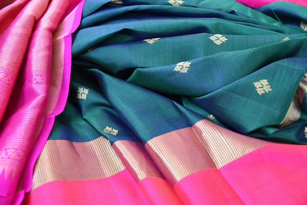 Classic and Elegant green and pink kanjivaram silk saree which have buta on all over body availlable at Pure Elegance on line and in store.  great buy for party-Close up of saree