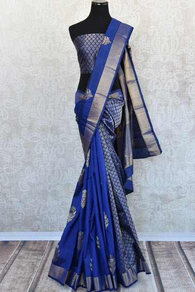 Find Kanjivaram silk saree with geometric pattern and Navy blue color- silver border at Pure Elegance.  Shop traditional Indian woven saree for party,reception-front view