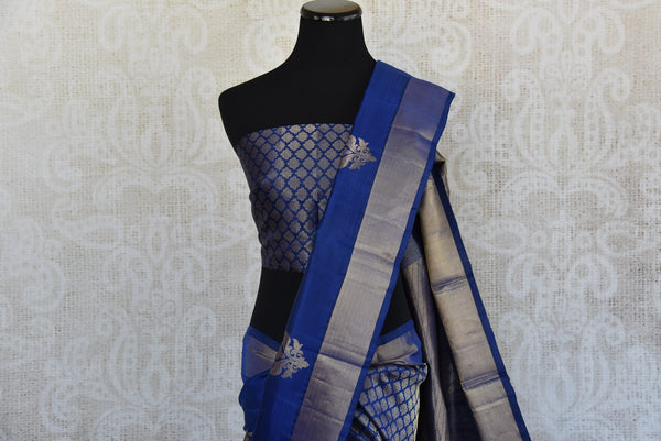 Find Kanjivaram silk saree with geometric pattern and Navy blue color- silver border at Pure Elegance.  Shop traditional Indian woven saree for party,reception. close up