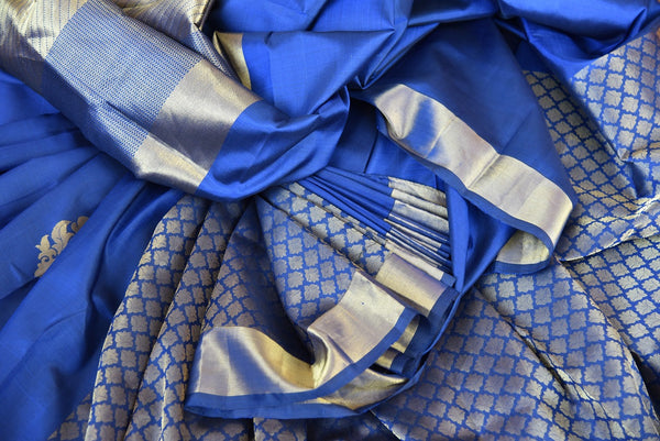Find Kanjivaram silk saree with geometric pattern and Navy blue color- silver border at Pure Elegance.  Shop traditional Indian woven saree for party,reception.over all view
