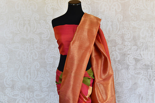 Reddish Pink Kanjivaram saree with gold pallu and broad border. This is half-n-half saree with pink and green checks after pleats.-pallu
