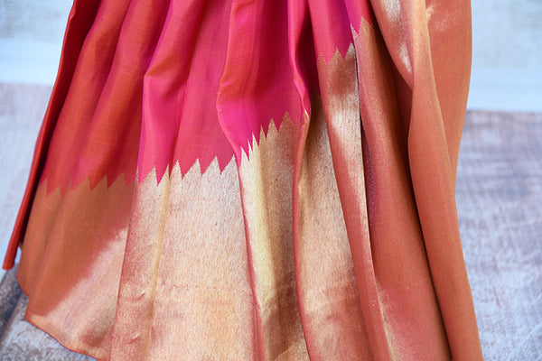 Reddish Pink Kanjivaram saree with gold pallu and broad border. This is half-n-half saree with pink and green checks after pleats.-gold border
