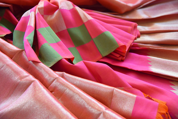 Reddish Pink Kanjivaram saree with gold pallu and broad border. This is half-n-half saree with pink and green checks after pleats.-close up