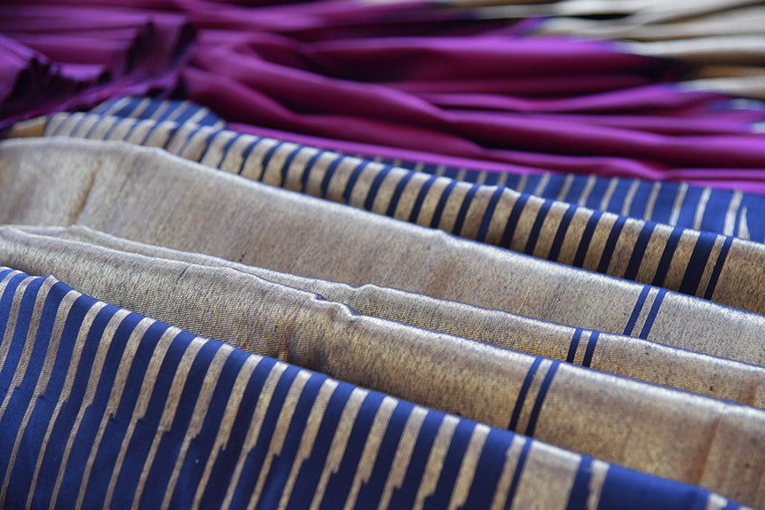 Kanjivaram silk saree in purple color with classic temple border. This traditional Indian piece is perfect for wedding.  -gold and blue pallu
