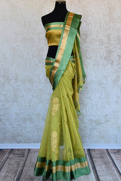 Kora Banarasi saree in green color available in Indian clothing store and Online in USA. This Sari has Banarasi buta on body and satin border makes it classy.-Full view