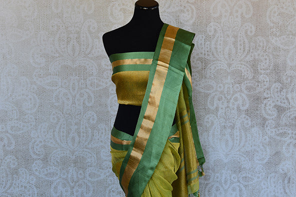 Kora Banarasi saree in green color available in Indian clothing store and Online in USA. This Sari has Banarasi buta on body and satin border makes it classy.-Pallu with blouse