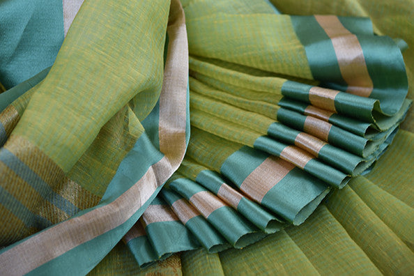 Kora Banarasi saree in green color available in Indian clothing store and Online in USA. This Sari has Banarasi buta on body and satin border makes it classy.-Close up