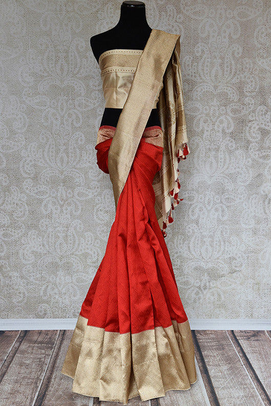 Red banarasi silk sari with beige gold border and pallu comes with beige blouse. Perfect ethnic collection.-full view