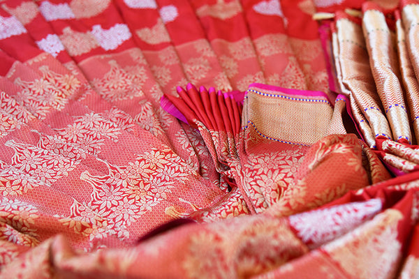 Ethnic Red Banarasi hand woven silk saree available at our Indian women clothing store Pure Elegance. This Elegant piece is ideal for Pujas and wedding parties.-close up