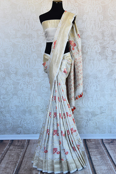 Off White classic khadi banarasi sari with red floral buta all over and gold border available in store in USA. Ideal buy for Indian weddings and parties.-full view