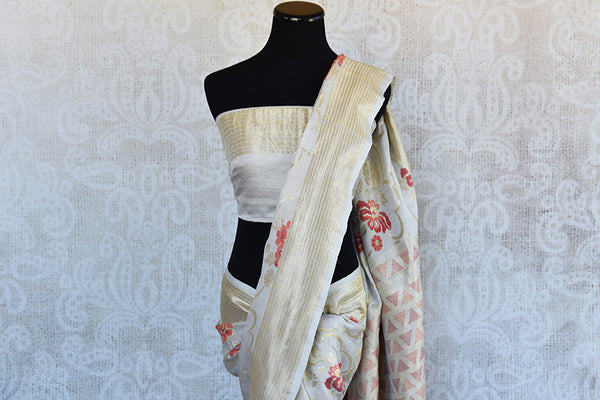 Off White classic khadi banarasi sari with red floral buta all over and gold border available in store in USA. Ideal buy for Indian weddings and parties.-gold border and pallu