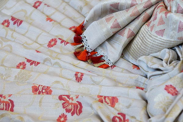 Off White classic khadi banarasi sari with red floral buta all over and gold border available in store in USA. Ideal buy for Indian weddings and parties.-close up