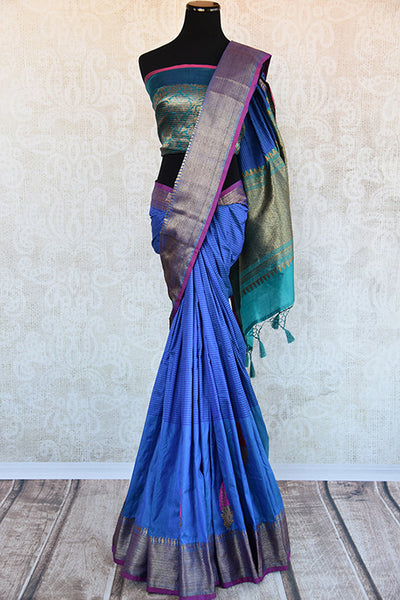 Classic tussar banarasi saree in blue which has buta on lower half and selfstripes on upper half with the hint of purple and light blue available online In USA-Full view