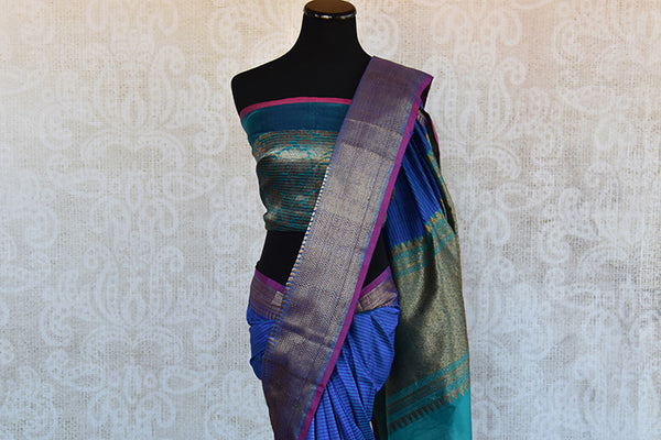 Classic tussar banarasi saree in blue which has buta on lower half and selfstripes on upper half with the hint of purple and light blue available online In USA-border and pallu