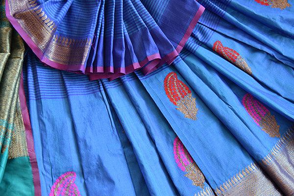 Classic tussar banarasi saree in blue which has buta on lower half and selfstripes on upper half with the hint of purple and light blue available online In USA-close up buta